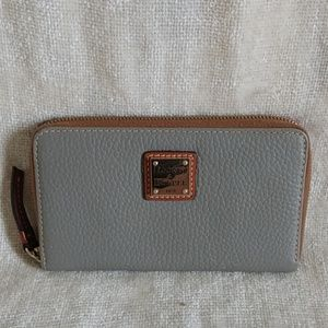 Authentic Dooney & Bourke zip wallet.